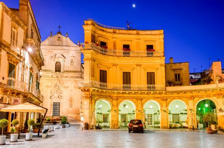Martina Franca, Puglia in Italy. Piazza Plebiscito and Basilica di San Martino at twilight.
