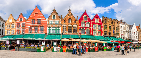 house gable: BRUGES, BELGIUM - 7 AUGUST 2014. Tourists on street cafes in Bruges, Markt is meeting place of the Brugelings and tourists in Brugge, Flanders.