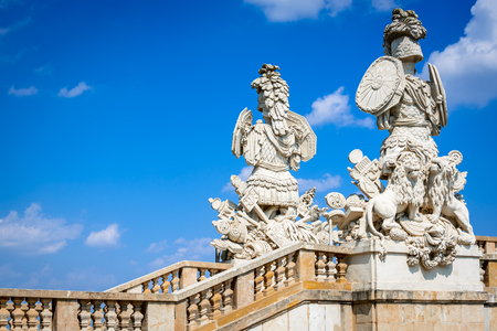 schonbrunn palace: VIENNA, AUSTRIA - 4TH AUGUST 2015: Sculpture of guardians at the Gloriette in Schoenbrunn Palace Garden, Vienna, Austria. Built in 1775 designed by architect Johann Ferdinand Hetzendorf von Hohenberg.