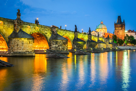 stare mesto: Prague, Czech Republic. Night view with Vltava River, Charles Bridge and Stare Mesto Old Town Tower. Twilight image of Bohemia capital. Stock Photo