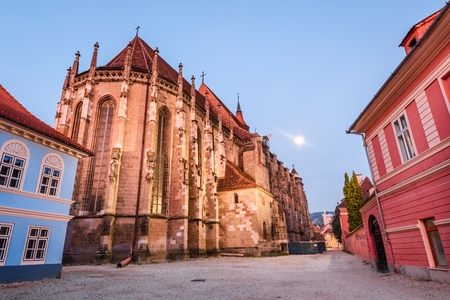 architectural architectonic: Brasov, Romania. Night image of Black Church built in medieval times in Council Square in downtown of Brasov, Transylvania. Stock Photo