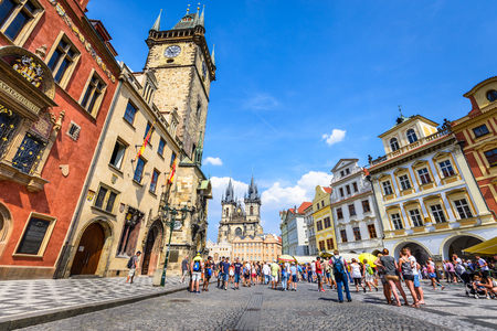 stare mesto: PRAGUE, CZECH REPUBLIC - 7th AUGUST 2015: Tourists in Stare Mesto Square with Old Town Tower and Tyn Church, main attraction of Prague, Bohemia.