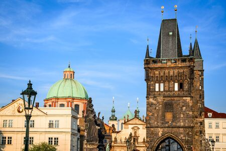 stare mesto: Prague, Czech Republic. Charles Bridge and Stare Mesto domes and spires of Prague's churches the city's main landmarks. Stock Photo