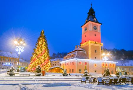 Brasov, Romania. Christmas Market in Main Square, with Xmas Tree and lights. Transylvania landmark.