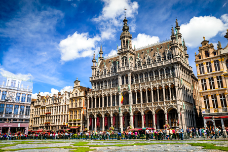 """Bruxelles: BRUXELLES, BELGIUM - 13 AUGUST 2014. Tourists in Grand Place, Maison du Roi, one of Europe finest historic squares and a """"must-see"""" sight of Brussels, Bruxelles."""