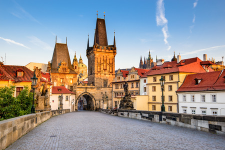 tower house: Prague, Czech Republic. Charles Bridge with its statuette, Lesser Town Bridge Tower and the tower of the Judith Bridge.