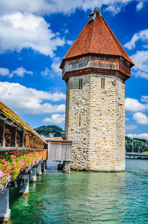confederation: Luzern, Switzerland. View of the famous wooden Chapel Bridge of Luzern, Lucerne in Swiss Confederation with the tower in foreground