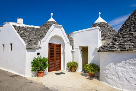 trulli: Alberobello, Italy, Puglia. Unique Trulli houses with conical roofs. Trullo, trulli, a traditional Apulian dry stone hut with a conical roof.