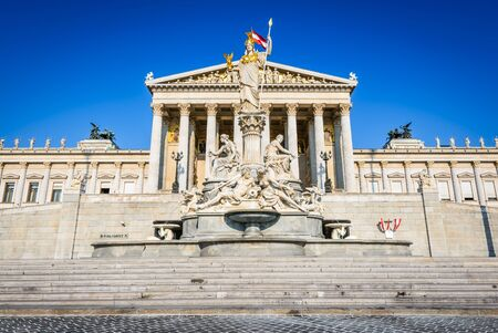 pallas: Panoramic view of Austrian parliament building with famous Pallas Athena fountain and main entrance in Vienna, Austria