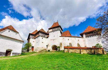 country church: Transylvania, Romania. Image of fortified church of Viscri, UNESCO heritage site, german landmark in romanian country.