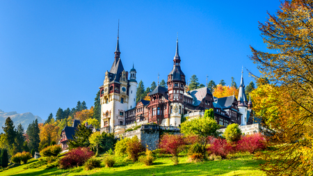 culture: Peles Castle, Romania. Beautiful famous royal castle and ornamental garden in Sinaia landmark of Carpathian Mountains in Europe