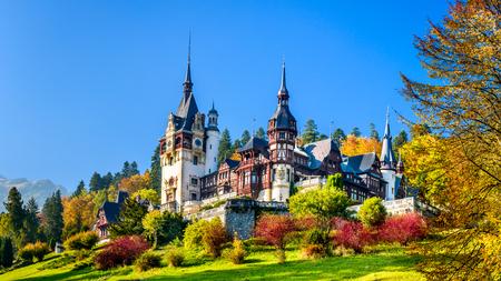 castle buildings: Peles Castle, Romania. Beautiful famous royal castle and ornamental garden in Sinaia landmark of Carpathian Mountains in Europe