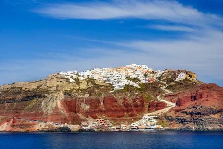 climbed: Thira, Santorini. Sunset landscape with idyllic town of Fira, climbed on volcanic mountain, Greek Islands in Aeagean Sea Stock Photo