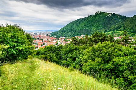 brasov: Brasov, Romania. Brasov cityscape with Tampa Mountain on backround in Transylvania Stock Photo