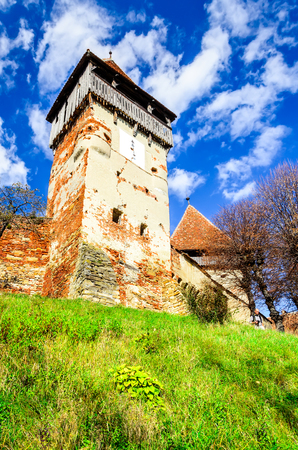 Transylvania, Romania. Medieval rural scenery with fortified churches. Alma Vii christian fortress was built in 16th century by Saxons.