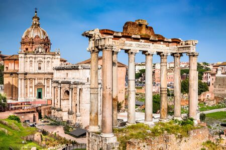 roman empire: Rome, Italy.  Sunset view with ruins of Imperial Forum, Roman Empire. Background with Colosseum (Colosseo or Coliseum).