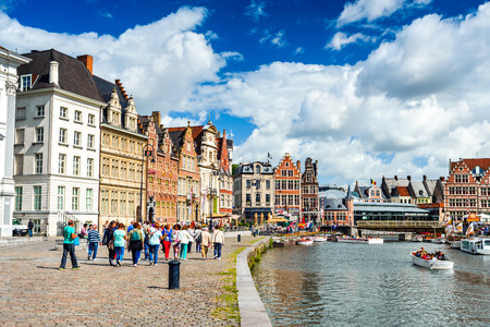 gent: GENT (GHENT), BELGIUM - 11 AUGUST 2014: Panoramic view from the St. Michael Bridge to the architecture the Leie river in the historic city center with channel and embankment (Graslei and Korenlei) Editorial