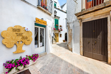 LOCORTONDO, ITALY - 10 JULY 2015: Medieval whitewashed street and houses in small city of Locorotondo, Puglia in Bari region.