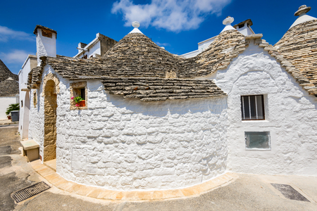 plastered wall: Alberobello, Italy, Puglia. Unique Trulli houses with conical roofs. Trullo, is an a traditional Apulian dry stone hut with a conical roof.