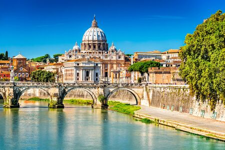 Rome, Italy. Vatican dome of Saint Peter Basilica (Italian: San Pietro) and Sant Angelo Bridge, over Tiber river.