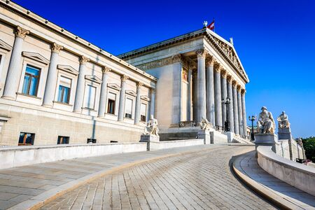 Panoramic view of Austrian parliament building with famous Pallas Athena fountain and main entrance in Vienna, Austria