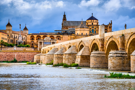 Cordoba, Spain, Andalusia. Roman Bridge on Guadalquivir river and The Great Mosque (Mezquita Cathedral).
