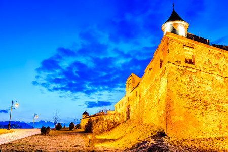 Brasov, Romania - Stunning twilight HDR image with medieval hilltop fortress of Corona - The Citadel, Transylvania