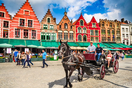 belgian horse: BRUGES, BELGIUM - 7 AUGUST 2014. Horse carriage on Grote Markt square. Belgian city of Bruges (Brugge) is UNESCO world heritage listed for its medieval center. Editorial