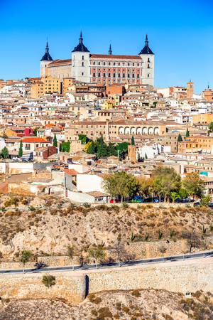 Toledo, Spain. Alcazar and the ancient city on a hill over the Tagus River, Castilla la Mancha medieval attraction of Espana. Editorial