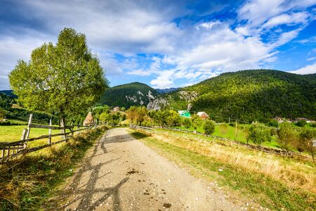 Carpathian Mountains, Romania. Rural landscape with Magura village in Piatra Craiului National Park. Stock Photo