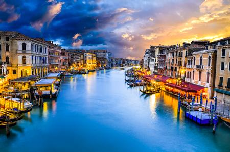 rialto: Venice, Italy. Famous Grand Canal view at twilight from Rialto Bridge. Venezia Laguna at Adriatic Sea.