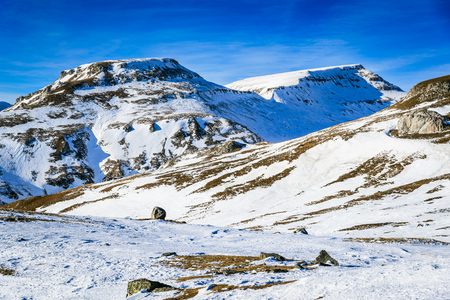 Bucegi Mountains, Romania. Stunning winter scenery in Carpathian Mountains ridge on touristic plateau of Bucegi.