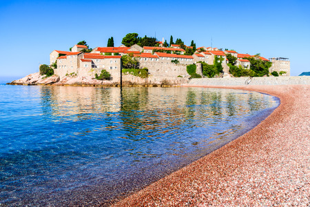 reverie: Sveti Stefan, Montenegro. View with fantastic small island and resort on the Adriatic Sea coast, Budva city region. Stock Photo