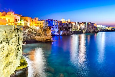 dwelling: Puglia, Italy. Sunset scenery of Polignano a Mare, town in the province of Bari, Apulia, southern Italia on the Adriatic Sea Stock Photo