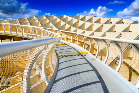 SEVILLA, SPAIN - 9 MAY 2016: Metropol Parasol in Plaza de la Encarnacion. J. Mayer H. architects, it is made from bonded timber with a polyurethane coating.