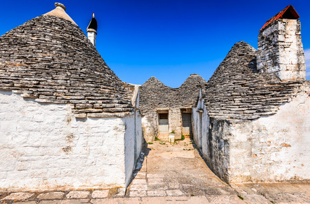 plastered wall: Alberobello, Italy, Puglia. Unique Trulli houses with conical roofs. Trullo, trulli, a traditional Apulian dry stone hut with a conical roof.