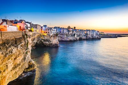 Puglia, Italy. Sunset scenery of Polignano a Mare, town in the province of Bari, Apulia, southern Italia on the Adriatic Sea Imagens