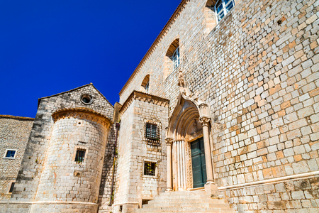 croatian: Dubrovnik, Croatia. Stairs of Dominican Monastery and medieval walls in old town of Ragusa (Dubrovnik) Stock Photo