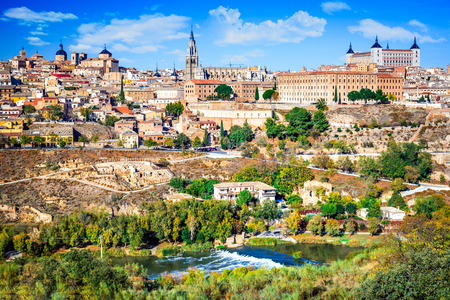 Toledo, Spain. Alcazar and the ancient city on a hill over the Tagus River, Castilla la Mancha medieval attraction of Espana. Stock Photo