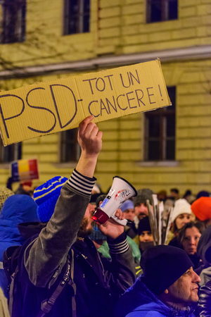 marched: BRASOV, ROMANIA - 1 FEBRUARY 2017: Massive protests in Brasov against planned measures aimed to defend corrupt officials. Some 20.000 people marched through the  Brasov city and 150.000 in Bucharest, Romanian capital and a total of  400.000 all over Roman Editorial