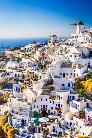 Santorini, Greece. Oia city with white and blue houses in Aegean Sea. Thira, Cyclades Islands. Stock Photo