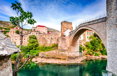 bosna and herzegovina: Mostar, Bosnia and Herzegovina. Morning sun on Nerteva River and Old City of Mostar, with Ottoman Mosque