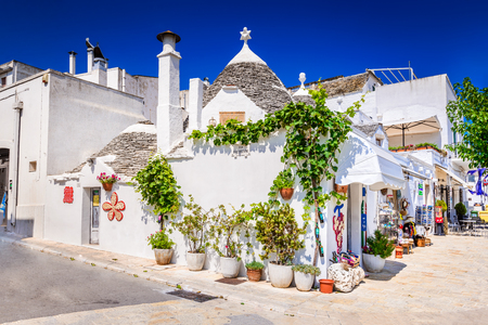 plastered wall: ALBEROBELLO, ITALY - 10 JULY 2015: Alberobello, UNESCO heritage city in Italy, Puglia. Trulli or Trullo houses with conical roofs,  traditional Apulian dry stone hut.