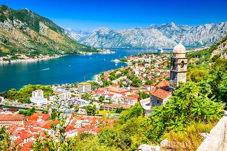 Kotor, Montenegro. Bay of Kotor bay is one of the most beautiful places on Adriatic Sea, it boasts the preserved Venetian fortress, old tiny villages, medieval towns and scenic mountains. 免版税图像 - 77145079