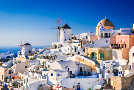 Santorini, Greece. Oia city with white and blue houses in Aegean Sea. Thira, Cyclades Islands. Stok Fotoğraf
