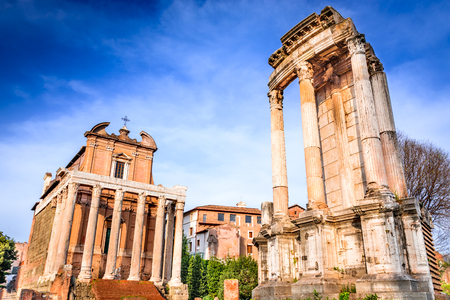 emporium: Rome, Italy. Ancient ruins of Roman Forum with Temple of Antoninus Pius and Faustina, ancient Roma city center, heart of empire.