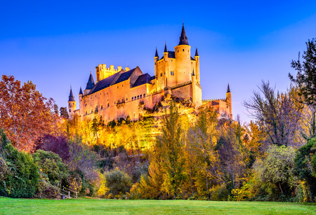 Segovia, Spain. Autumn dusk view of Castle of Segovia, known as Alcazar and built in 12th century in Castile and Leon