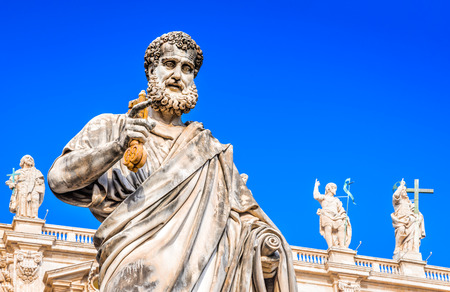 Vatican City, Rome, Italy. Statue of Saint Peter and Saint Peters Basilica at background in St. Peters Square.