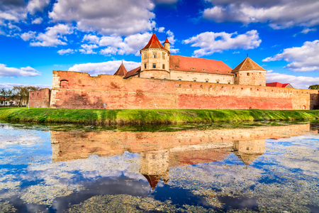 Fagaras, Romania. Cloudy scenery with Fagaras Citadel, built in Transylvania in XVth century. Stock Photo