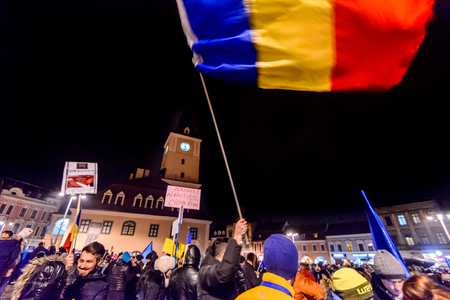 BRASOV, ROMANIA - 3 FEBRUARY 2017: The 4th day of successive biggest anti-corruption protest in decades in Romania. Almost 400.000 Romanians demonstrated against government decree decriminalizing some corruption offences. Editorial